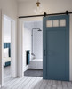 custom wood bathroom sliding barn door with 3 windows in blue finish