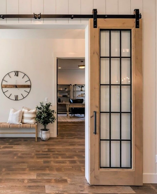 Rustic Wood Frame French Sliding Barn Door in foyer leading to the dining room