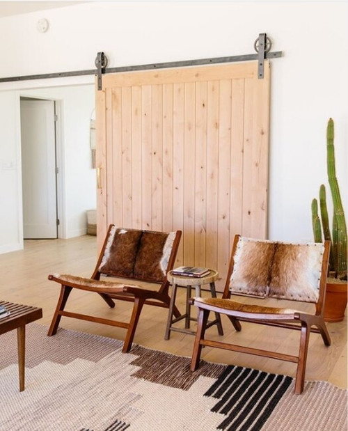 raw wood annapolis sliding barn door in desert styled living room