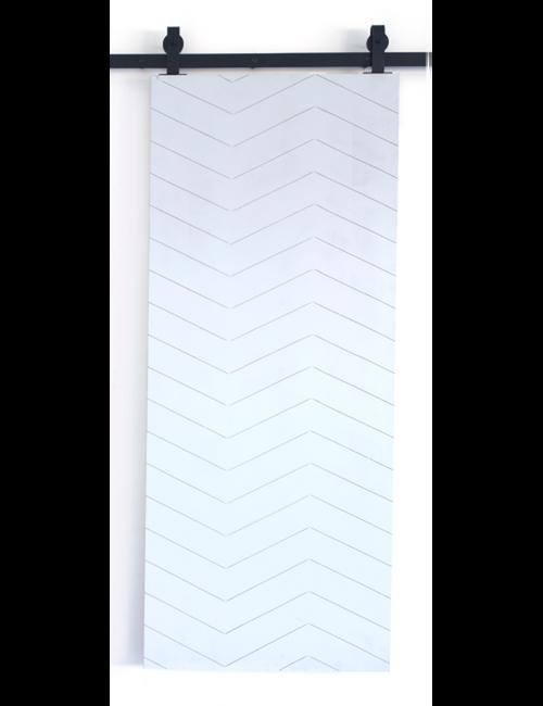 white painted wood barn door with triple herringbone pattern