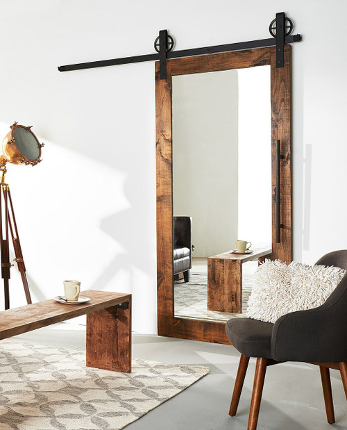 stained wood barn door with full pane mirror