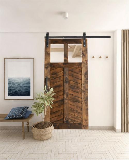 light chevron wood dual glass pane stained chevron panel barn door lifestyle bedroom door in california
