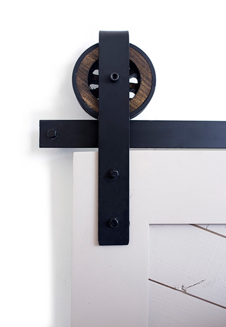 rustic barn door hardware with wooden wheel and front strap
