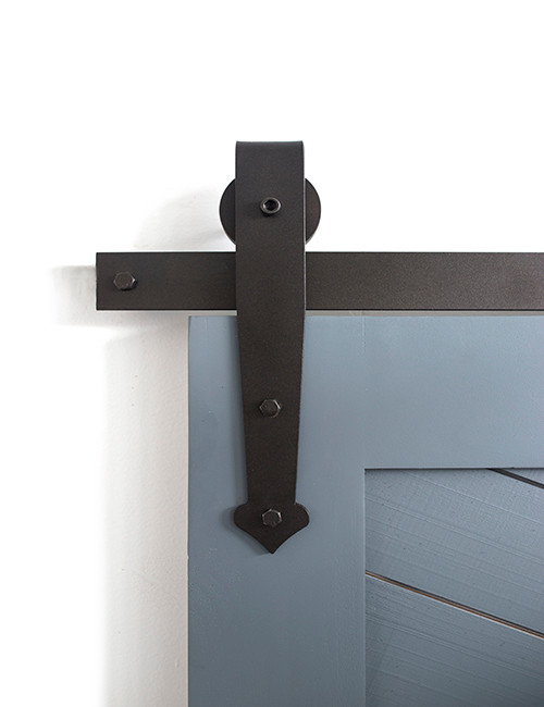 black barn door hardware with stylized front strap with arrow