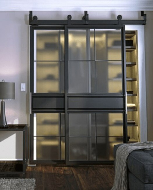 metal bedroom closet bypass barn door with two panel square pane glass