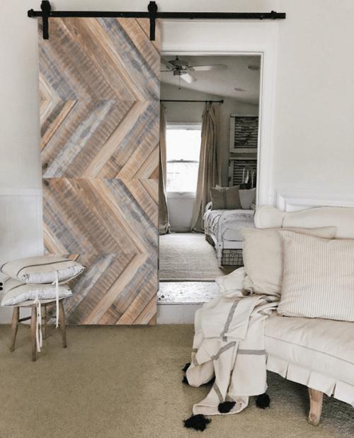 gray clark reclaimed wood barn door lifestyle - living room