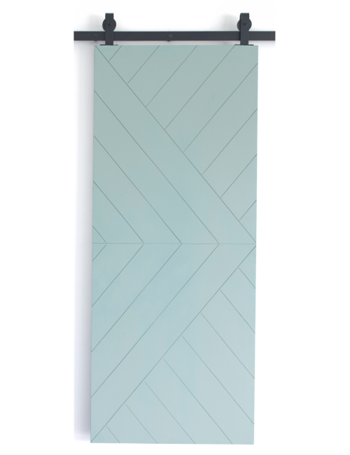 teal painted wood barn door with etched design