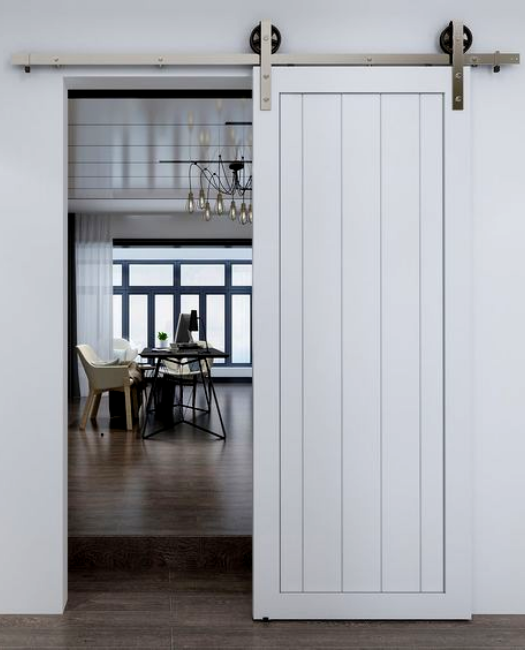 Hudson painted white with vertical planks leading to the dining room custom sliding barn door.
