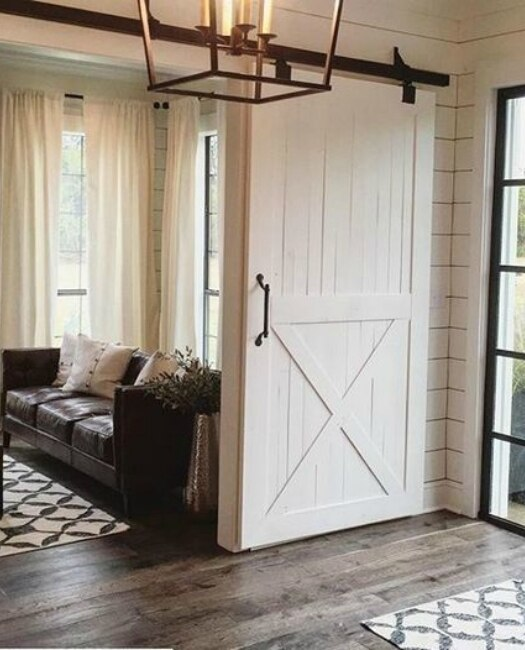 Lake Placid Wood classic door painted white used in foyer and enterence to living room with standard black hardware