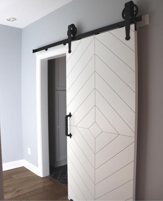 White Modern Diamond Pattern Sliding Barn Door to laundry room off kitchen