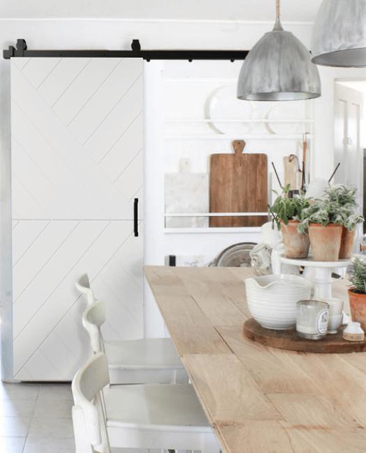 Modern Aoorw Barn Door Painted White Installed in kitchen as pantry barn door