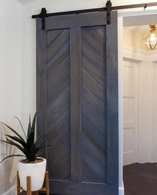 foyer chevron dark blue stain sliding barn door