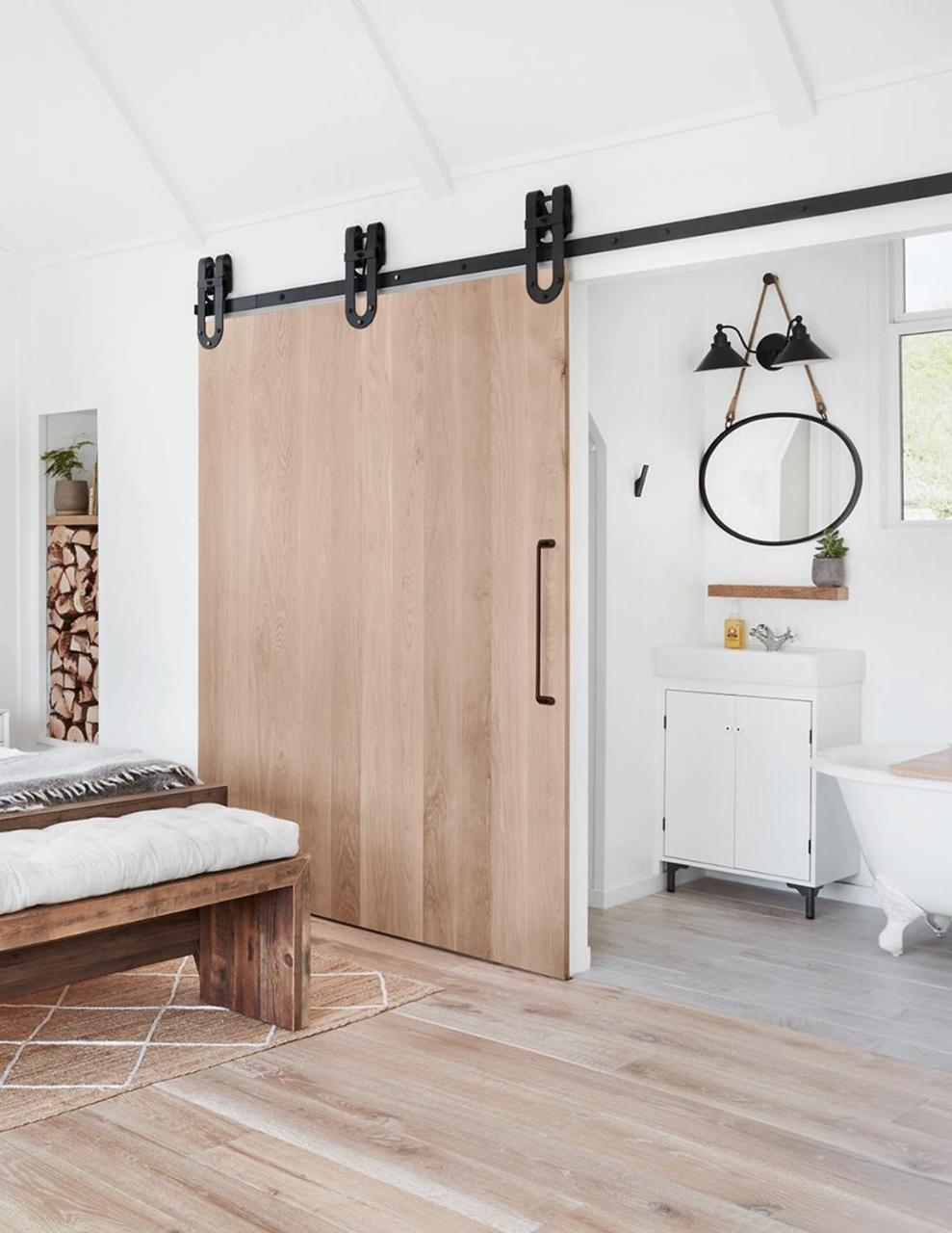 Custom oak Slab Barn Door In bedroom connecting to master to bathroom