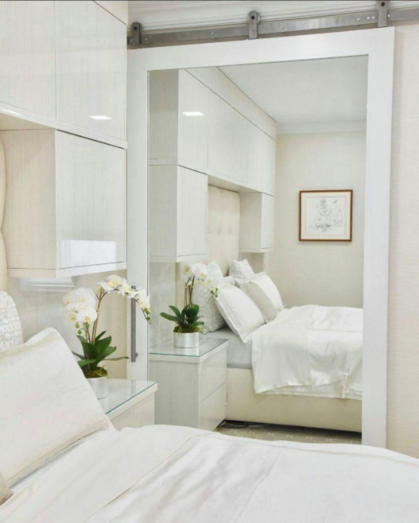 chic bedroom with mirror sliding barn door