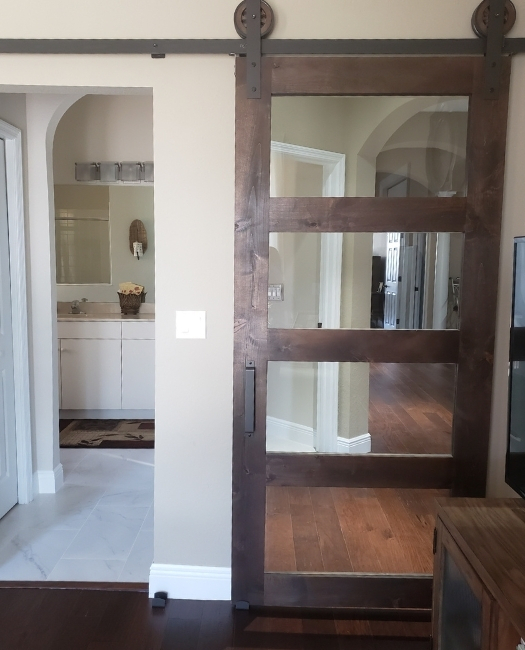 Stained Wood 4 Panel Glass Master Bathroom Sliding Barn Door