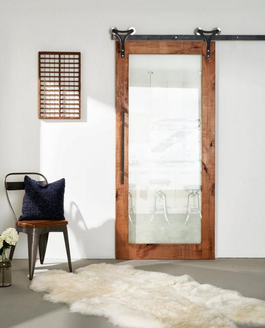 lifestyle of wood frame full panel clear glass  sliding barn door