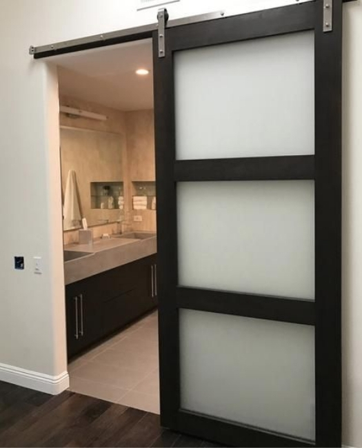 frosted glass three panel wood frame bathroom barn door