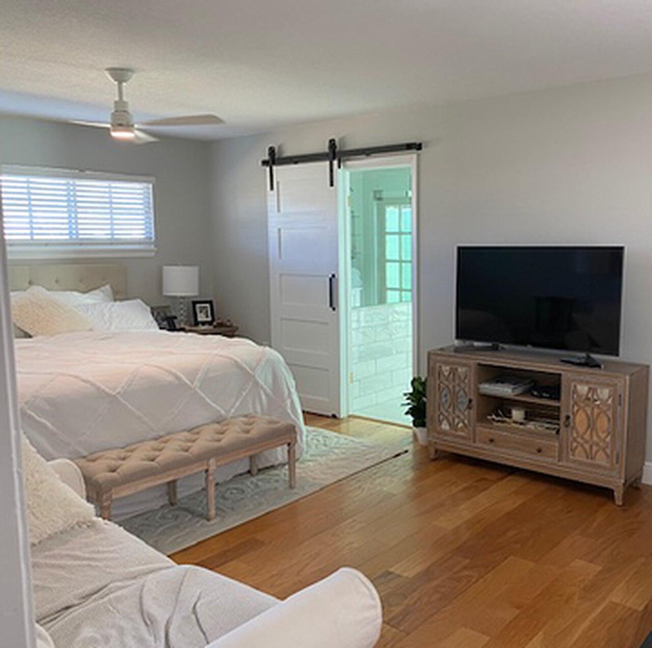 5 panel white painted wood bedroom barn door