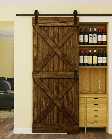 newport wood pantry barn door with double x board and batten design