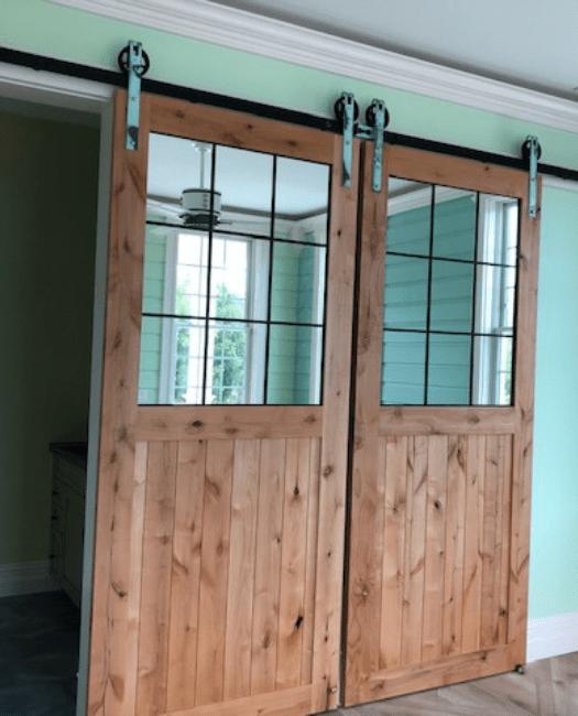 Rustic Half Panel French Double Barn Door Lifestyle bathroom with custom mirrors