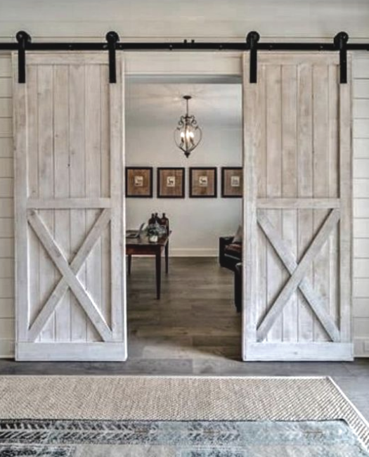 white washed double sliding barn door in our lake placid style
