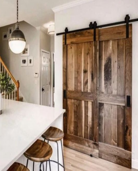 Naples bypass double barn door in kitchen as a pantry door.