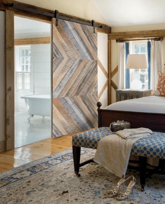 gray lewis reclaimed wood horizontal triple herringbone barn door lifestyle bedroom bathr