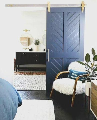 blue painted wood 4 panel chevron bathroom barn door