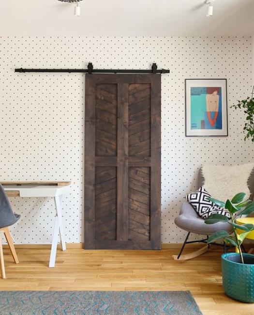 dark stained 4 panel chevron sliding wood barn door