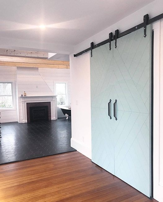 double teal painted wood barn door with etched design