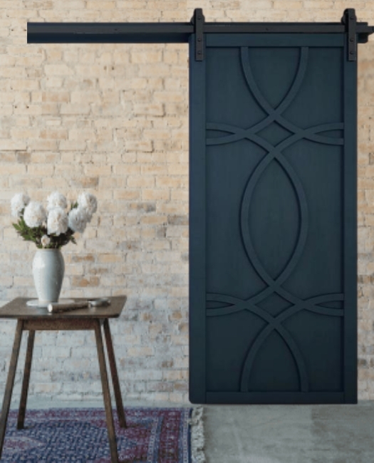 The Alice Swirl Wood custom sliding barn door in midnight blue