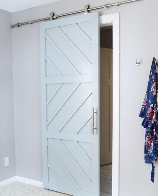 custom wood sliding barn door in baby blue with geometric pattern