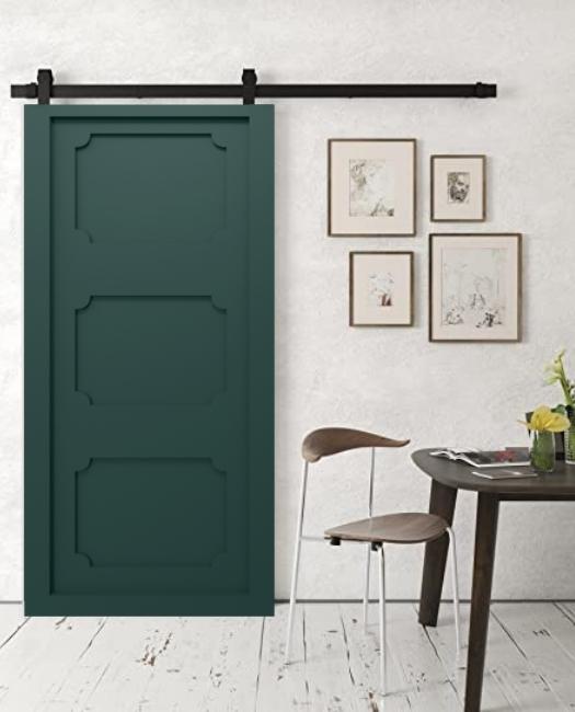 deep green sliding barn door dining room
