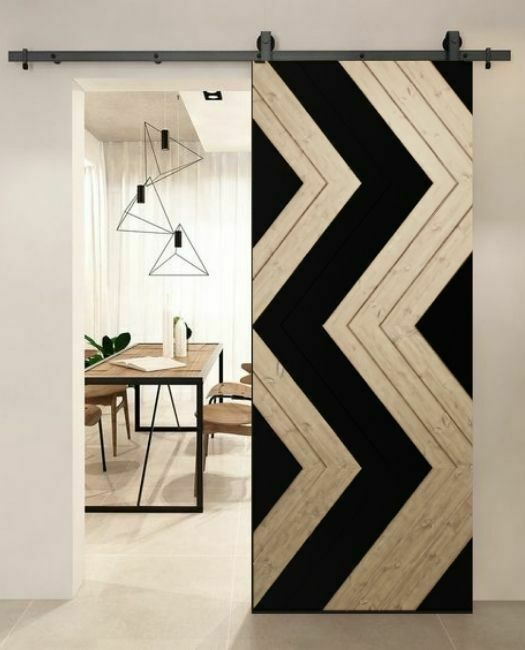 boho natural oak with black paint zigzag pattern sliding barn door to dining room