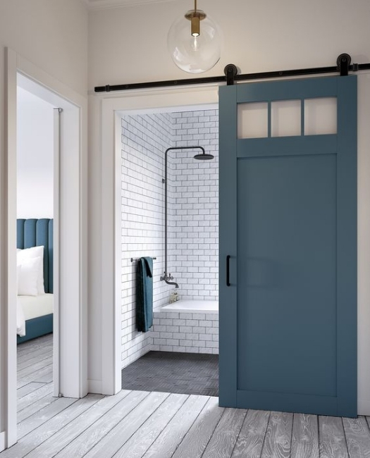custom wood bathroom sliding barn door with 3 windows in blue finish