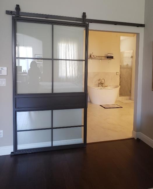 8 pane glass metal sliding barn door with cross bar