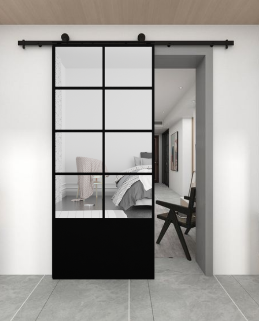The Vivian 8 Panel Mirror Sliding Barn Door With Kick Plate. Lifestyle image of bedroom door.