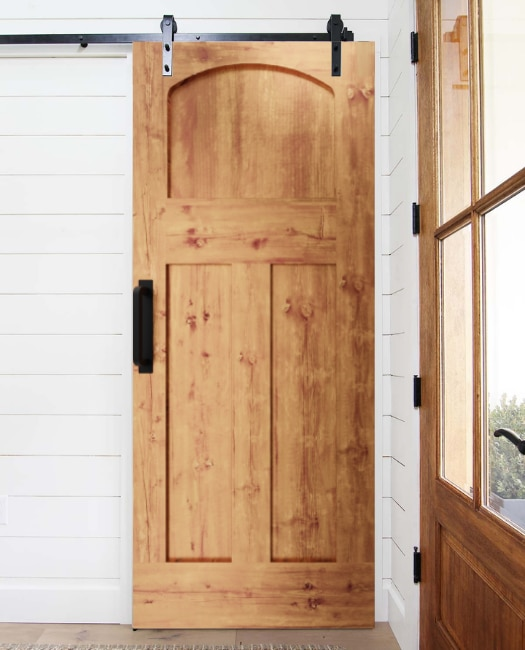 entry way sliding barn door made of real wood and 3 panel shaker with arched top
