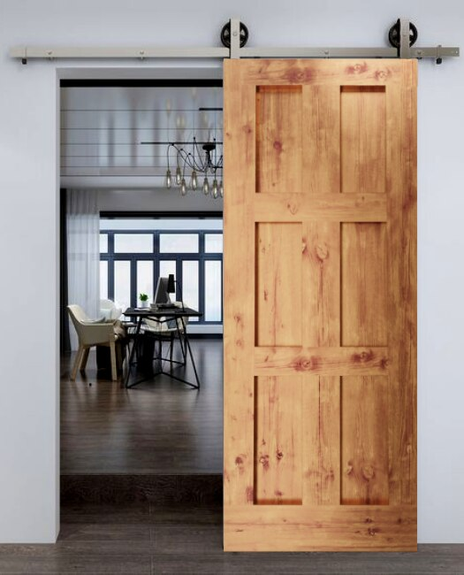 Dining room custom sliding barn door made of real wood and six vertical panel shaker style.