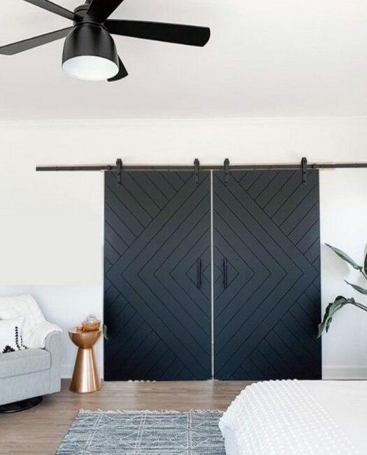 black modern arrown double custom sliding barn door in family room