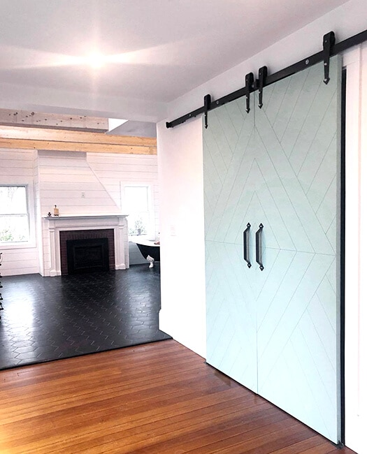 custom paint color modern arrow sliding barn door in living room