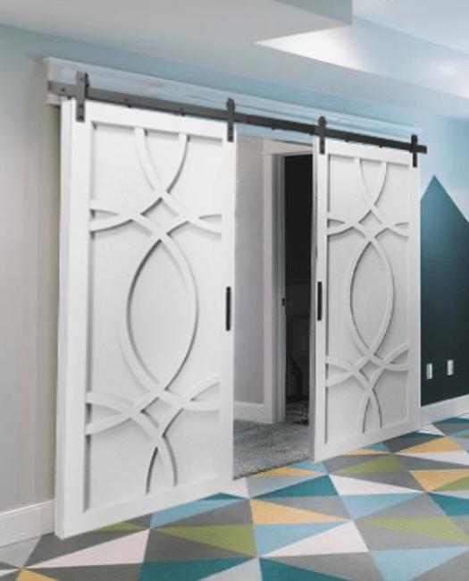 The Alice Wood Swirl Custom Double Sliding Barn Door Painted White - Lifestyle Basement