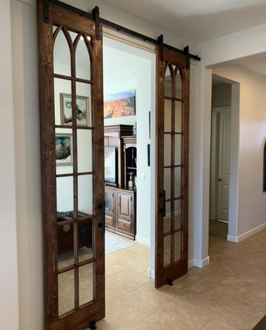 Double version on the Archie wood frame mirror with custom grid sliding barn doors. Lifestyle of hallway french doors.