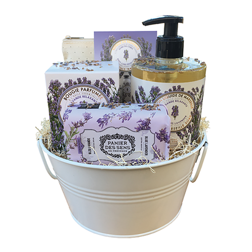 """Lavender Fragrance Gift Basket  A basket full of joy is guaranteed with this Lavender scent. Give the gift of relaxation with this basket that has a multitude of products that not only smell good, but feel good on your skin too! Basket comes beautifully wrapped in a cellophone wrapping tied with ribbon made from rafia.  Composition / • Relaxing Lavender Pouch Set by Panier des Sens • Lavender Scented Candle 6 oz by Panier des Sens • Lavender Liquid Marseille Soap 16.9 fl.oz by Panier des Sens • Blue Lavender Shea Butter Soap 7 oz By Panier des Sens • Round galvanized 8"""" tub that can be reused for anything of your choice.  Dimensions & More Info / • Product Size / W.8"""" – H.13"""" – D.8"""""""