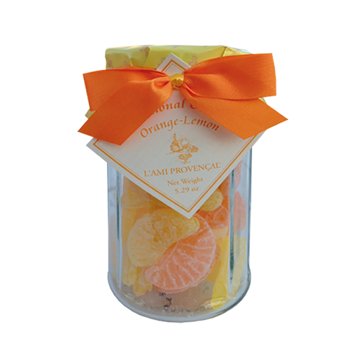 """Citrus Old Fashioned Candy - 5.3 oz  French citrus old-fashioned Provencal gourmet candy is a wonderful gift or an indulgent sweet treat for yourself. Packaged in a 12-sided glass jar with screw-on lid under the paper wrapper and ribbons, each candy is in the shaped like orange or lemon wedge. This candy is crafted in the quaint and picturesque town of Equilles, near the sunny region of Aix-en-Provence.  Dimensions & More Info / • Net Weight / 5.3 oz – 150 g • Made In / FRANCE """"Provence""""  Ingredients or Nutrition Facts / • Sugar • Glucose syrup • Sugar • Citric acid • Natural flavor of lemon and orange • Tumeric • Paprika extract • Water"""