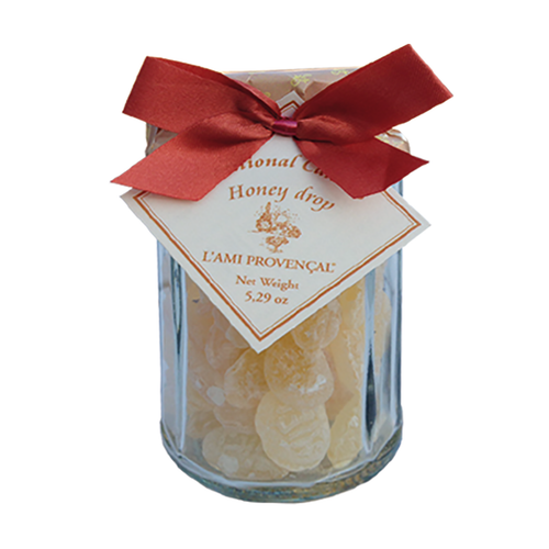 """Honey Old Fashioned Candy - 5.3 oz  French honey old-fashioned Provencal gourmet candy is a wonderful gift or an indulgent sweet treat for yourself. Packaged in a 12-sided glass jar with screw-on lid under the paper wrapper and ribbons, each candy is in the shaped like a honey bee. This candy is crafted in the quaint and picturesque town of Equilles, near the sunny region of Aix-en-Provence.  Dimensions & More Info / • Net Weight / 5.3 oz – 150 g • Made In / FRANCE """"Provence""""  Ingredients or Nutrition Facts / • Sugar • Glucose syrup • Wheat • Honey • Water"""