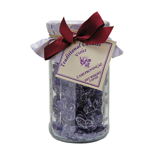 """Violette Old Fashioned Candy - 5.3 oz  French violette old-fashioned Provencal gourmet candy is a wonderful gift or an indulgent sweet treat for yourself. Packaged in a 12-sided glass jar with screw-on lid under the paper wrapper and ribbons, each candy is in the shape of a small berry. This candy is crafted in the quaint and picturesque town of Equilles, near the sunny region of Aix-en-Provence.  Dimensions & More Info / • Net Weight / 5.3 oz – 150 g • Made In / FRANCE """"Provence""""  Ingredients or Nutrition Facts / • Sugar • Glucose syrup of wheat • Citric acid • Natural flavor • Carmine • Water"""