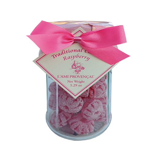 """Raspberry Old Fashioned Candy - 5.3 oz  French raspberry old-fashioned Provencal gourmet candy is a wonderful gift or an indulgent sweet treat for yourself. Packaged in a 12-sided glass jar with screw-on lid under the paper wrapper and ribbons, each candy is in the shape of a small berry. This candy is crafted in the quaint and picturesque town of Equilles, near the sunny region of Aix-en-Provence.  Dimensions & More Info / • Net Weight / 5.3 oz – 150 g • Made In / FRANCE """"Provence""""  Ingredients or Nutrition Facts / • Sugar • Glucose syrup of weat • Citric acid • Natural flavor • Carmine • Water"""