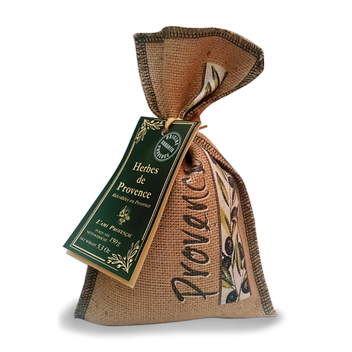 """Provence Herbs in Burlap Bag - 5.3 oz  Herbs de Provence by l'Ami Provencal is known for their finest Provencal herbs. This unique blend is home to the southern coastal region of France, known as Provence. The magnificence of the Mediterranean sunshine and fertile landscaping provides the most optimal growing environment for the herbs Marjoram, Rosemary, Bay leaves, Thyme, and Summer Savory that create this aromatic bouquet of wellness for the mind and body. Each Burlap bag contains 5.3 ounces of Provence herbs by l'Ami Provencal from France.  Dimensions & More Info / • Product Size / W.5"""" – H.9"""" – D.3"""" • Net Weight / 5.3 oz – 150 g • Made In / FRANCE """"Provence""""  Ingredients or Nutrition Facts / • Rosemary • Marjoram • Savory • Thyme • Basil"""