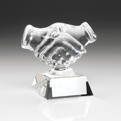 A magnificent clear glass handshake trophy. This award includes FREE personalised engraving.